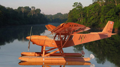 A Ch801 floatplane resting on a river in the rainforest